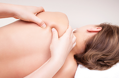 Women receiving a deep tissue massage.