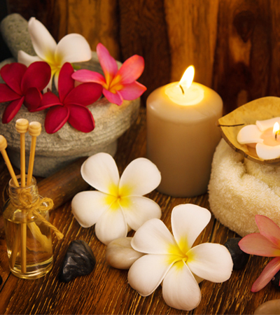 Flowers and candles set the mood for a prenatal massage.