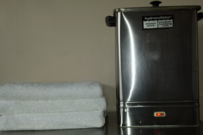 Towels and warming equipment ready for thermal therapy.