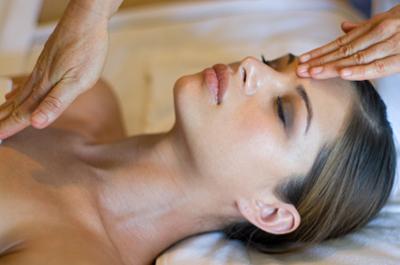 Woman receiving a blended massage.