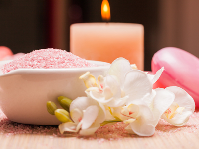 Setting the mood with candles and flowers for geriatric massage therapy.