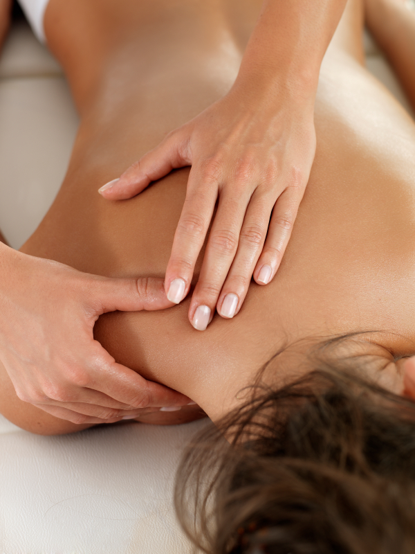 Woman receiving medical massage therapy.
