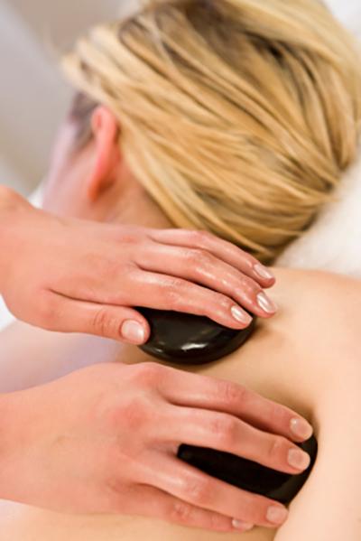 Woman receiving a hot stone massage.