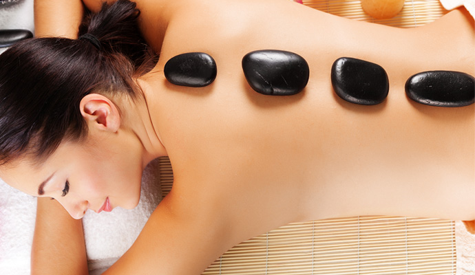 Relax with hot stone massage therapy.