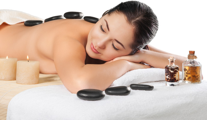 Stay warm this winter with hot stone massage therapy.